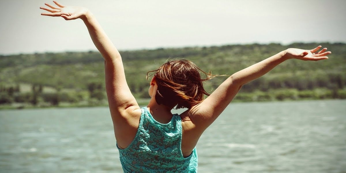 happy-woman-with-arms-in air