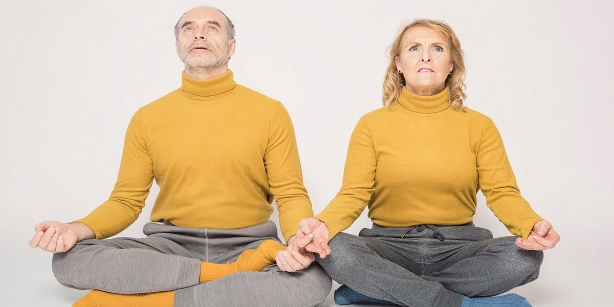 man-and-woman-with-legs-crossed-meditating